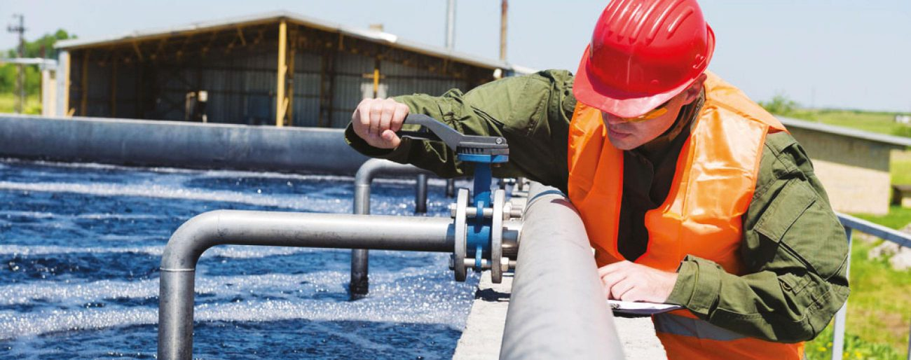 man working on pipes of water treatment plant