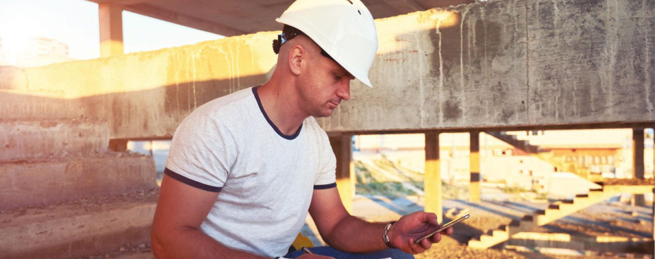 construction worker checking phone app