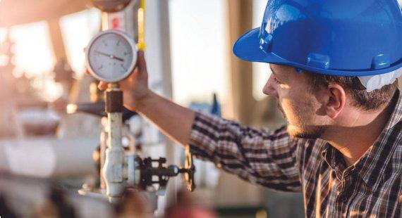 worker checking instrument valve