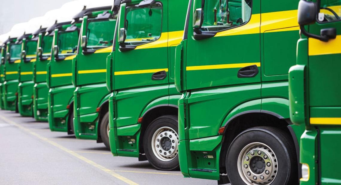 parked fleet of trucks - fleet and asset management software